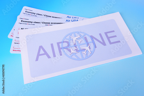 Airline tickets on light blue background