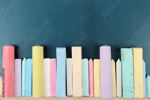 Colorful chalks on school desk