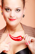 Beautiful woman fashion girl with red lips and chilli pepper