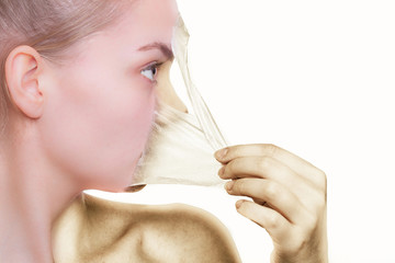 Face profile woman in facial peel off mask. Peeling. Skin care.