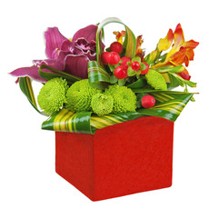 Bouquet from orchids and lilies in red vase isolated on white ba