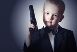 Handsome Boy with Gun.Fashionable Spy in Suit.Little James Bond