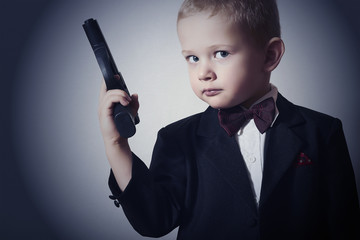 Handsome Boy with Gun.Fashionable in Suit.Little James Bond