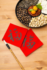 Chinese new year snack box and chinese calligraphy, meaning for