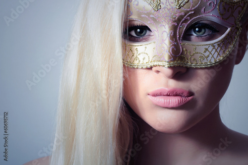 Beautiful Blond Woman in a Carnival Mask.Masquerade.Sexy Girl