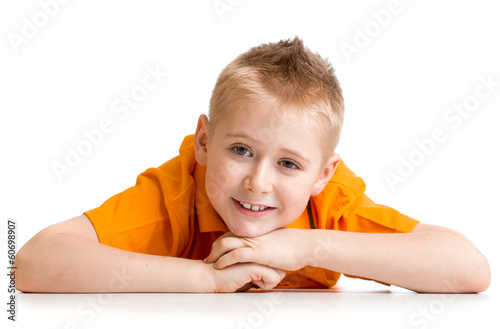Smiling boy lying on floor isolated on white