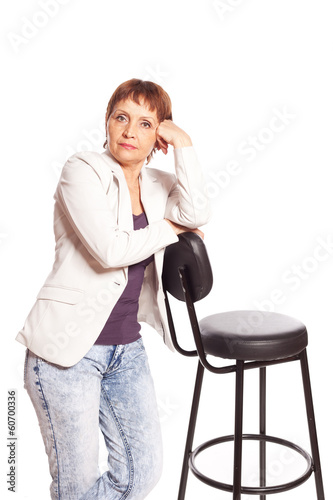 Pensive attractive woman 50 years