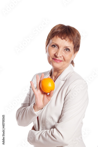 attractive woman 50 with orange in hand