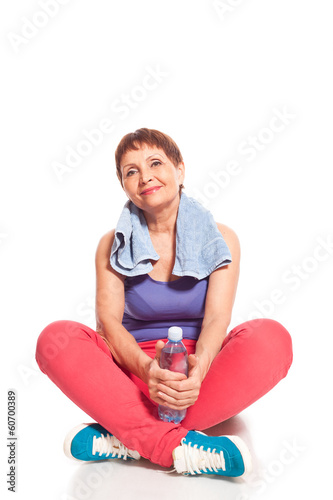 attractive woman 50 years old with a bottle of water