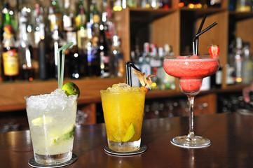 varied colorful cocktails, gin and tonic, mojito, and daikiri