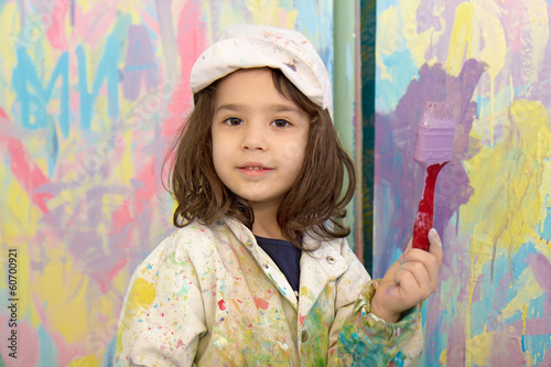 Girl painting wall