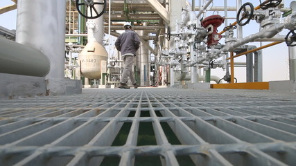 Engineer walking in refinery plant