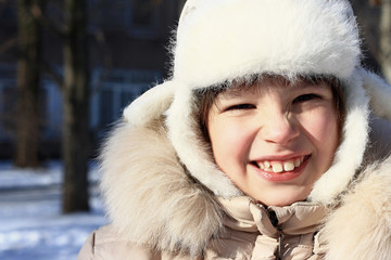 Little girl  plays outdoors in the winter.