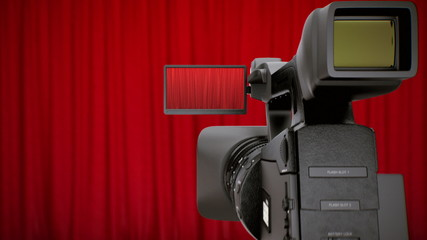 Camera in theater with red curtains