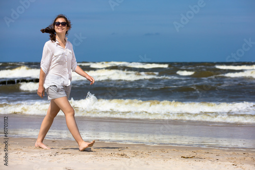 Teenage girl walking on beach