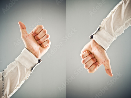 Businessman showing thumb up and thumb down symbol