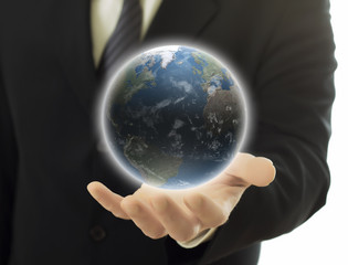businessman holding earth globe in hand