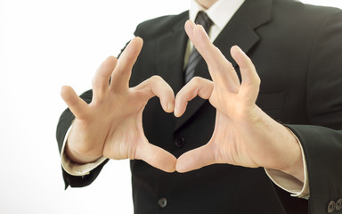 businessman shows a heart shape with his hands