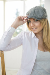 Woman on chair with stylish grey hat