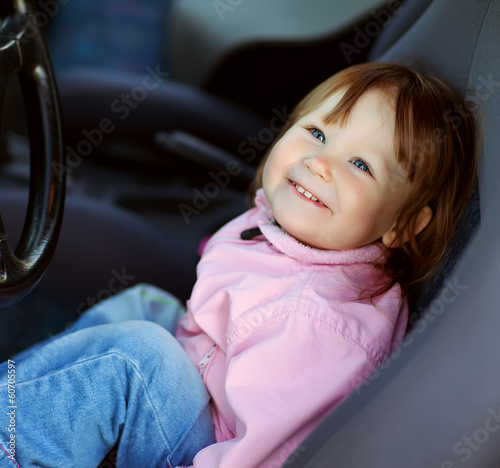 Driving little girl
