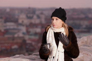 Young woman drinking coffee in Vilnius, Lithuania
