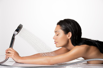 Photo of a woman in shower washing hair and body