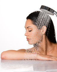 beautiful brunette woman holds shower in hands