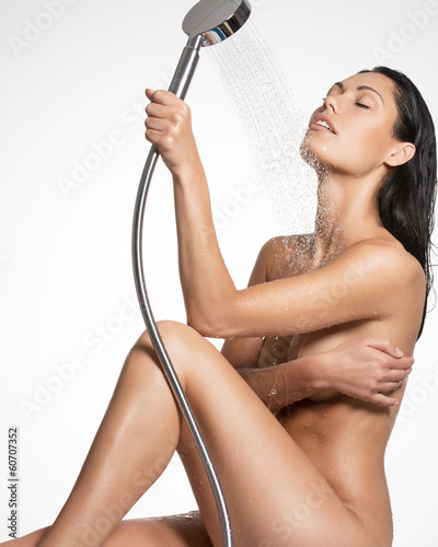 Sexy beautiful woman in shower washing  body