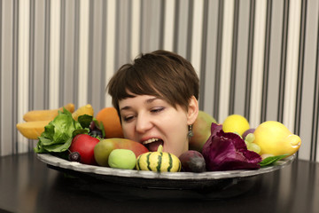 Woman biting fruits