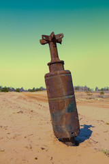 old rusty bom in a sand desert