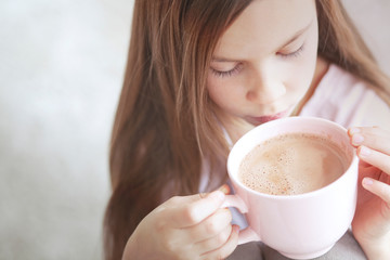 Child drinking cocoa