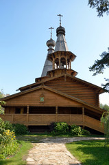 The Orthodox Church of logs with wooden domes