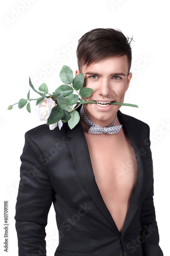 Young handsome stylish man in a jacket with a flower