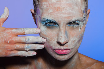 Horizontal portrait of woman with paint on face