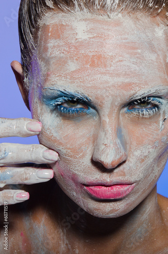 Vertical portrait of woman with paint on his face