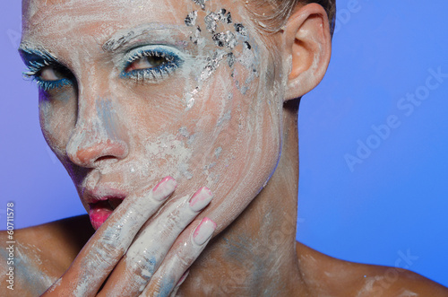 Young woman spreads over face paint