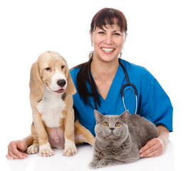 laughing veterinarian hugging cat and dog. isolated on white