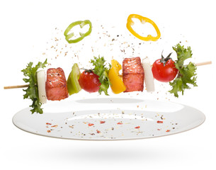 salmon with vegetables on a skewer