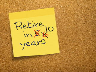 Retirement - pension delay, sticky note on cork