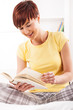 Young smiling women reading book