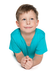 Thoughtful young boy on the white background