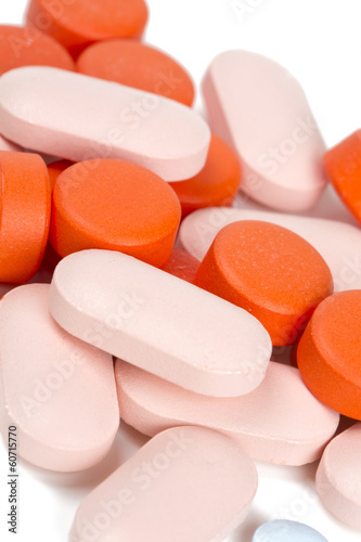 pile of different pills isolated on white