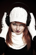 Red hair woman with winter outfit listening to music