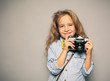 Child with camera.