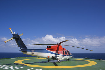 Shut down engine helicopter on oil rig helipad