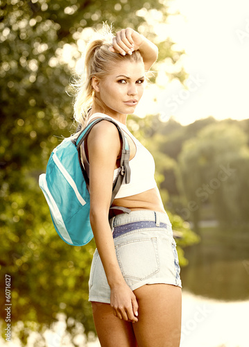 beautiful girl hiking outdoors leading a healthy lifestyle