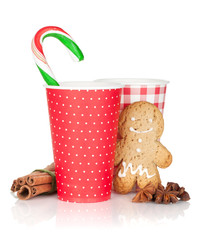 Christmas mulled wine with gingerbread cookie and candy cane