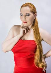 portrait red-haired woman in a red dress