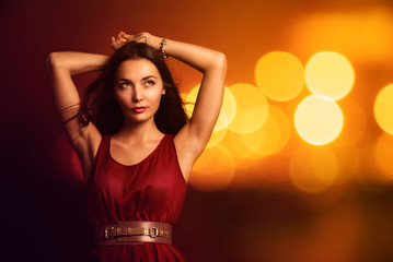 Beautiful Young Woman over Bright Night Lights