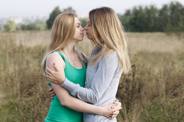 Two sisters or female friends in a close embrace